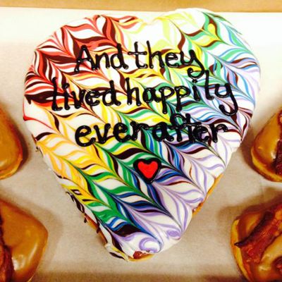 Heart Shaped iceed doughnut iced with the words And they lived happily ever after.