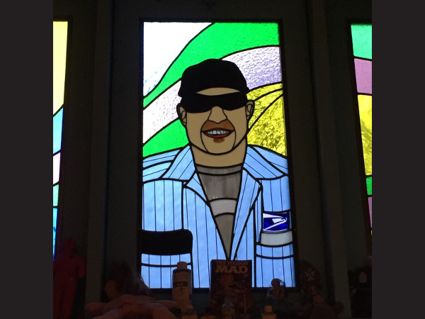 Spike the Mailman | Stained Glass Window at Voodoo Doughnut