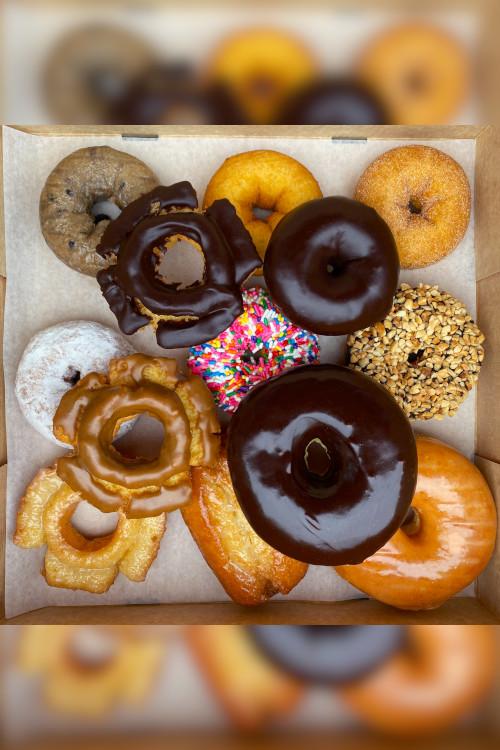 A top down shot of a Voodoo Classic Dozen Doughnuts.