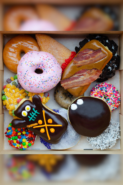 Top down image of a box of Voodoo Dozen Doughnuts