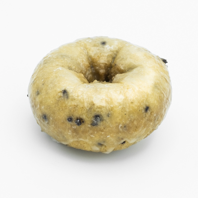 Image of a cake doughnut with blueberries showing in the dough, and a light glaze
