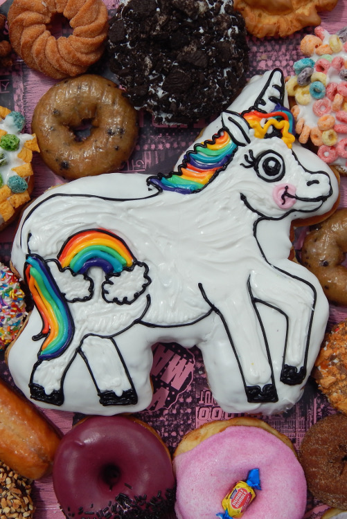Horse-shaped and iced doughnut with rainbows and other doughnuts