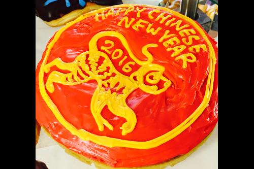 Chinese New Year Doughnut Round Red with Yellow Icing