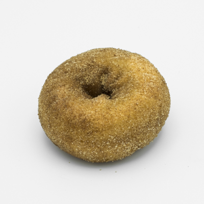Image of a plain cake doughnut covered with cinnamon sugar.