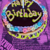 Happy Birthday Chocolate Iced Doughnut with Candle