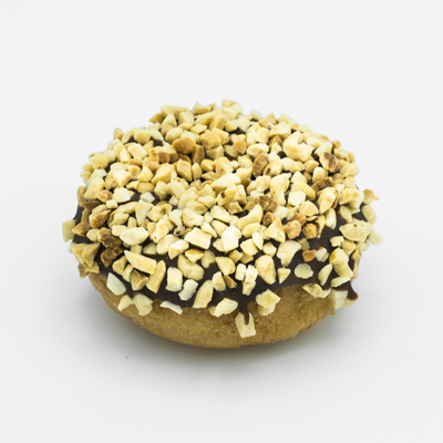 Image of a plain cake doughnut, dipped in chocolate frosting and coated with chopped peanuts.