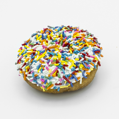 Image of a cake doughnut with vanilla frosting and covered in multi-colored sprinkles.