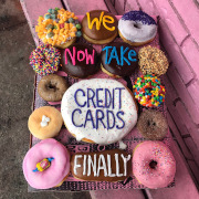 Doughnuts that have the words We Now Take Credit Cards Finally in icing.